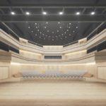 Theaterbühne mit dunkelgrauer Decke und beigen Holzflächen.